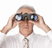 Serious Businessman Looking Through Binoculars - Isolated